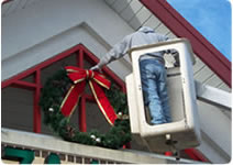 giant outdoor building front wreath Christmas decoration installation